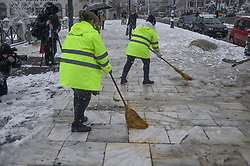 Municipal workers , the syntagma square, in the center of Athens, during a rare heavy snowfall in the city on February 16, 2021.