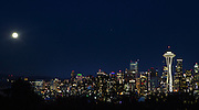 The blue moon is seen above the Seattle skyline from Kerry Park on Queen Anne hill in Seattle on Friday, July 31, 2015. A blue moon occurs when there are two full moons in one month.<br /> <br /> Lindsey Wasson / The Seattle Times