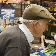 Man  at vegetable market stall, Brick lane market, London<br />
