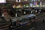 People wait for buses home from Shibuya after a magnitude .9 earthquake hit the Tohoku region of north east Japan causing tremors in Tokyo that stopped the train and cellphone networks. Many people were stranded in the centre of Tokyo over night. Tokyo, Japan Friday March 11th 2011