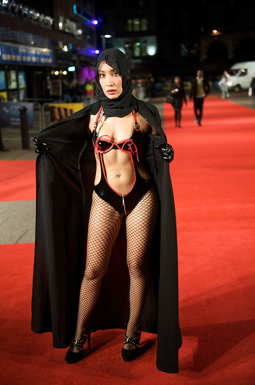 Actress Sofia Hayat bedecked in a hijab, disrobes into a dominatrix costume for a performance piece alerting others to the oppression many Muslim woman face, while promoting the Albert Kennedy Trust.  She performed for a small audience after the bulk of film goers had already arrived for the premiere of 'The Men Who Stare at Goats' on Thursday night, October 15, 2009, at the Odeon, Leicester Square in London, as part of the 53rd BFI London Film Festival.
