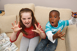 White girl and black boy being monsters after reading 'Where the wild things are'