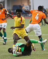 Photo: Steve Bond/Richard Lane Photography.<br />Ivory Coast v Benin. Africa Cup of Nations. 25/01/2008. Keeper Boubacar Barry gathers at the feet of incoming Razack Omotoyossi