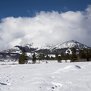 A view of Mammoth Mountain as the remnants of a winter storm ocscure the top.