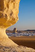 Chalk sculptures catch the setting sunlight in the White Desert, Egypt