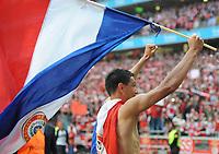 20100509: LISBON, PORTUGAL - SL Benfica vs Rio Ave: Portuguese League 2009/2010, 30th round. In picture:  Oscar Cardozo celebrating with the Paraguay flag. PHOTO: Alvaro Isidoro/CITYFILES