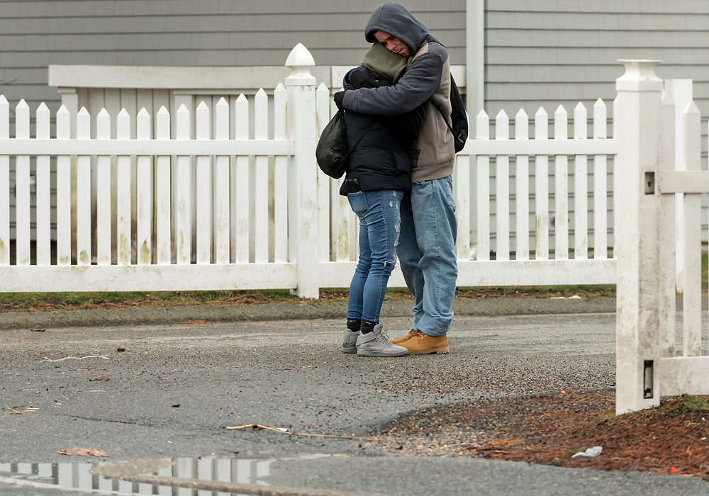 HYANNIS - Robert Walker and Megan Joseph share an embrace to stay warm while waiting for emergency shelter St. Jospeh House to open on Monday, March 30, 2020. The Barnstable County Department of Human Services is working with other area nonprofits to accommodate shelter overflow during the pandemic.