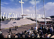 Pope John-Paul II visits Ireland..1979..29.09.1979..09.29.1979..29th September 1979..Today marked the historic arrival of Pope John-Paul II to Ireland. He is here on a three day visit to the country with a packed itinerary. He will celebrate mass today at a specially built altar in the Phoenix Park in Dublin. From Dublin he will travel to Drogheda by cavalcade. On the 30th he will host a youth rally in Galway and on the 1st Oct he will host a mass in Limerick prior to his departure from Shannon Airport to the U.S..Under the iconic Cross members of the congregation queue to receive Holy Communion from Pope John-Paul II.
