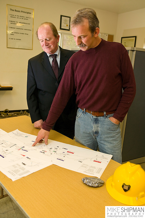 CEO and safety officer review plans in briefing room of a silver mine, Idaho