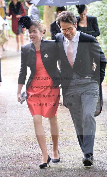 VICTORIA TRYON and her husband at the wedding of Princess Florence von Preussen second daughter of Prince Nicholas von Preussen to the Hon.James Tollemache youngest son of the 5th Lord Tollemache held at the Church of St.Michael & All Angels, East Coker, Somerset on 10th May 2014.