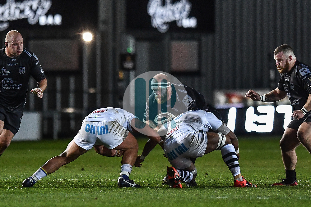 Joseph Davies of Dragons is tackled by Maxime Mbanda of Zebre<br /> <br /> Photographer Craig Thomas/Replay Images<br /> <br /> Guinness PRO14 Round 7 - Dragons v Zebre - Saturday 30th November 2019 - Rodney Parade - Newport<br /> <br /> World Copyright © Replay Images . All rights reserved. info@replayimages.co.uk - http://replayimages.co.uk