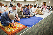 "Sept. 10 - GLENDALE, AZ:  Muslim men pray in the Glendale Civic Center in Glendale, before Eid ul-Fitr services. Muslims from the Phoenix area celebrated Eid ul-Fitr, the end of Ramadan, at the Glendale Civic Center in Glendale, AZ, a suburb of Phoenix. Eid ul-Fitr, often abbreviated to Eid, is the Muslim holiday that marks the end of Ramadan, the Islamic holy month of fasting. Eid is an Arabic word meaning ""festivity"", while Fitr means ""conclusion of the fast""; and so the holiday symbolizes the celebration of the conclusion of the month of fasting from dawn to sunset during the entire month of Ramadan. The first day of Eid, therefore, is the first day of the month Shawwal that comes after Ramadan.  Photo by Jack Kurtz"