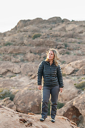 Sarah Hepola on rock ledge, Hueco Tanks State Park & Historic Site, El Paso, Texas. USA.