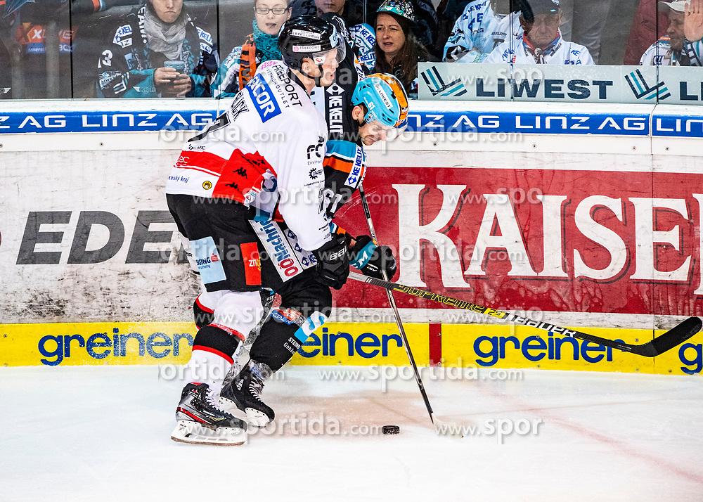 26.12.2019, Keine Sorgen Eisarena, Linz, AUT, EBEL, EHC Liwest Black Wings Linz vs HC Orli Znojmo, 31. Runde, im Bild v.l. Robert Flick (HC Orli Znojmo), Juraj Valach (EHC Liwest Black Wings Linz) // during the Erste Bank Eishockey League 31th round match between EHC Liwest Black Wings Linz and HC Orli Znojmo at the Keine Sorgen Eisarena in Linz, Austria on 2019/12/26. EXPA Pictures © 2019, PhotoCredit: EXPA/ Reinhard Eisenbauer