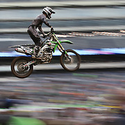 A blur of motion as Tony Archer, Kawasaki, flies through the air during the Monster Energy AMA Supercross series held at MetLife Stadium. 62,217 fans attended the event held for the first time at MetLife Stadium, New Jersey, USA. 26th April 2014. Photo Tim Clayton