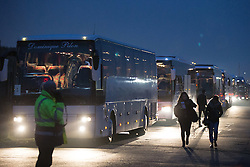 © Licensed to London News Pictures . 24/10/2016 . Calais , France . Buses queued up to evacuate thousands of migrants from the Jungle migrant camp in Calais , Northern France , on the day of a planned eviction and start of the destruction of the camp . Photo credit: Joel Goodman/LNP