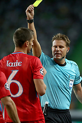 August 15, 2017 - Lisbon, Portugal - Referee Felix Brych from Germany shows the yellow card to Steaua's defender Ionut Larie during the UEFA Champions League play-offs first leg football match between Sporting CP and FC Steaua Bucuresti at the Alvalade stadium in Lisbon, Portugal on August 15, 2017. (Credit Image: © Pedro Fiuza/NurPhoto via ZUMA Press)