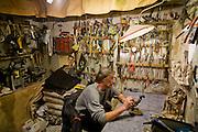 Art restorer Vyacheslav Grankovskiy in his studio in Schlisselburg, outside St. Petersburg, Russia. (Vyacheslav Grankovskiy is featured in the book What I Eat: Around the World in 80 Diets.)  MODEL RELEASED.
