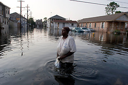 05 Sept  2005. New Orleans, Louisiana. Post hurricane Katrina.<br /> Residents who refuse to leave. A lady wades through the water where some residents of Uptown New Orleans refuse to leave the devastated flood areas.<br /> Photo; ©Charlie Varley/varleypix.com