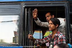 Bus workers in the Bhaktapur Bus Depot in Kathmandu. Thursday, November 14, 2019. Photography ©2019 Michael Lichter.