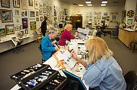 Beverly Shanley, Gisela Langsten and BJ Eckardt work on their paintings at the NH Open Doors in conjunction with Lakes Region Art Association at the Tanger Outlet on Sunday afternoon.  (Karen Bobotas/for the Laconia Daily Sun)