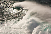 Gigantic Atlantic storm waves crash over the reef at Cape Cornwall near St Just, backlit by early morning sunlight. The sound of the sea was deafening and relentless and my camera lens needed cleaning every few seconds, covered as it was by soft spray that blew over 100 ft into the air