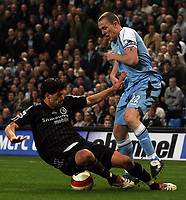 Photo: Paul Thomas.<br /> Manchester City v Chelsea. The Barclays Premiership. 14/03/2007.<br /> <br /> Richard Dunne (R) of City is tackled by Michael Ballack.