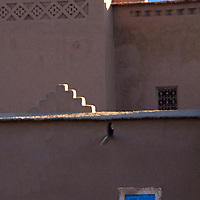Africa, Morocco, Skoura. Kasbah with blue window shutters.