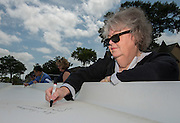 Melanie Hauser signs a beam during a ceremony at Lee High School, May 25, 2016.