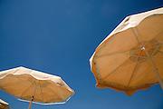 Sunshades against deep blue Mediterranean sky