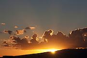 Sunset behind a mountain ridge in Hawaii
