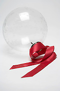 red ribbon with a glass boll