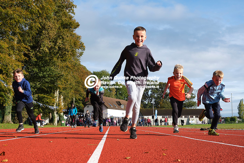 19/10/2019, Official opening of Dunboyne AC Track & facility<br /> Young Dunboyne athletes try out the new track to a background of the official opening ceremony<br /> Photo: David Mullen / www.quirke.ie ©John Quirke Photography, Unit 17, Blackcastle Shopping Cte. Navan. Co. Meath. 046-9079044 / 087-2579454.<br /> ISO: 320; Shutter: 1/1000; Aperture: 5.6; <br /> File Size: 56.3MB