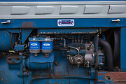 A blue Ford tractor engine at the Suffolk Show on the 29th May 2019 in Ipswich in the United Kingdom. The Suffolk Show is an annual show that takes place in Trinity Park, Ipswich in the English county of Suffolk. It is organised by the Suffolk Agricultural Association.