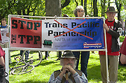 Protesters at a 2015 May Day rally in Portland, Oregon hold a sign opposing the Trans Pacific Partnership or TPP.