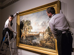 "Christie's, St James, London. Gallery technicians adjust the painting vas Christie's in London announce the sale of a work of genius by John Constable, the full scale six-foot ""sketch"" for ""View on the Stour near Dedham"" painted between 1821 and 1822, which is expected to fetch between £18-22 million at auction."