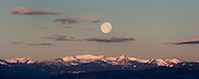 Moon setting over the Spanish peaks in Montana