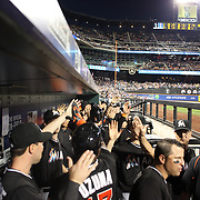 NEW YORK, NEW YORK - July 05: Miami Marlins players give high fives in the dugout after Giancarlo Stanton #27 of the Miami Marlins three run home run during the Miami Marlins Vs New York Mets regular season MLB game at Citi Field on July 05, 2016 in New York City. (Photo by Tim Clayton/Corbis via Getty Images)