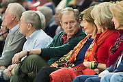 DALLAS, TX - DECEMBER 16: Former U.S. President George W. Bush speaks with his wife Laura Bush during an NCAA basketball game between the SMU Mustangs and the Nicholls State Colonels on December 16, 2015 at Moody Coliseum in Dallas, Texas.  (Photo by Cooper Neill/Getty Images) *** Local Caption *** George W. Bush; Laura Bush