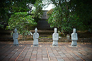 Stone statues lined up in Tu Duc Tomb, Hue, Vietnam, Southeast Asia
