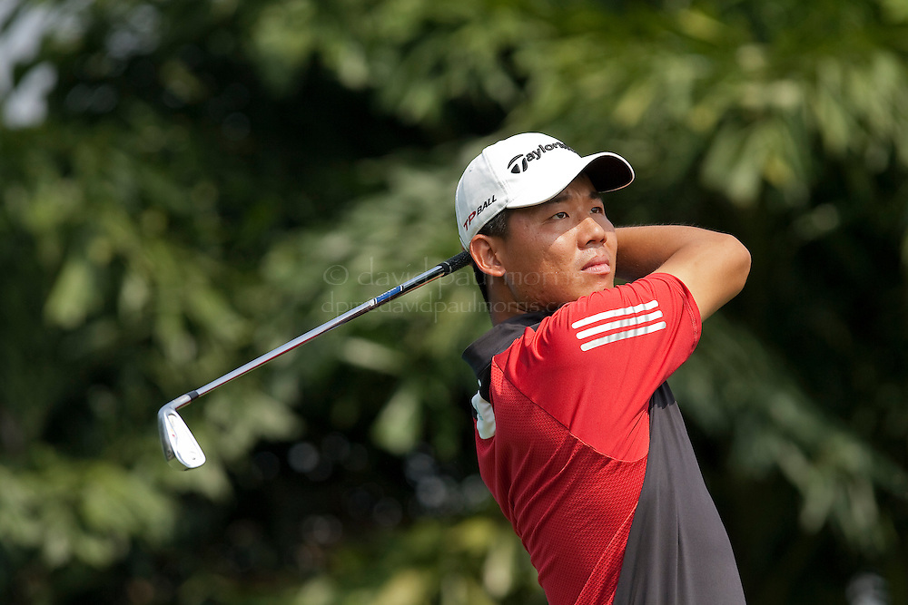 SHUNGDE, CHINA - OCTOBER 15: Alex Wu Ashun of China hits his tee shot on the 3rd hole during round one of the 2009 Midea China Classic at the Royal Orchid International Golf Club October 15, 2009 in Shunde, China.  (Photograph by David Paul Morris/OneAsia)
