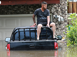 Juan Arteaga, of Round Lake Beach, Ill., sits on his flooded pickup truck in the 100 block of Wildwood Drive on Wednesday, July 12, 2017. Photo by Joe Shuman/Chicago Tribune/TNS/ABACAPRESS.COM