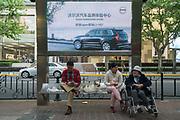 Street scene Shanghai, Volvo car consumer advertising with saenior citizens