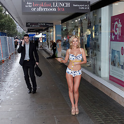 © licensed to London News Pictures. LONDON, UK  05/05/2011. Lingerie model Amanda-Jane (pictured) and head lingerie fitter Mina Abban-Mensah (not pictured) conduct a live bra outside of Debenhams on Oxford Street. .85% of British women are thought to wear the wrong size bra. A fitting will take place on the hour until 4pm today. Please see special instructions for usage rates. Photo credit should read CLIFF HIDE/LNP