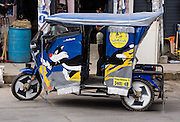 A mototaxi (three-wheeled auto rickshaw) provides cheap public transportation in the Santa Valley (Callejon de Huaylas), Huaraz, Ancash Region, Andes Mountains, Peru, South America.