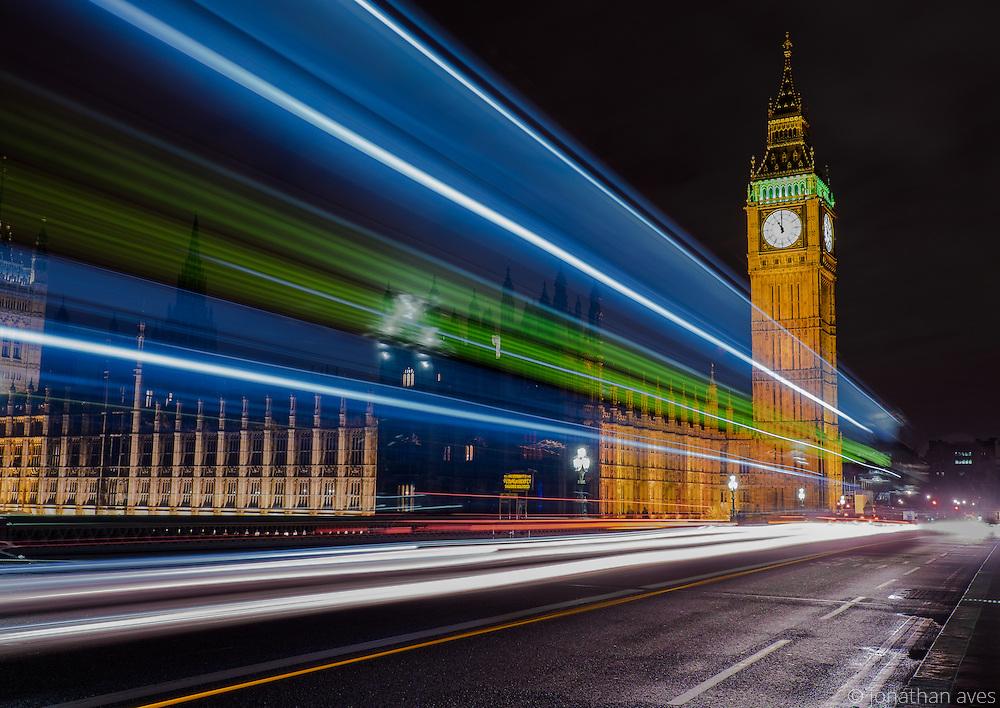 A London Bus crosses Big Ben on  Westminster Bridge.