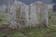 Gravestones in country church graveyard in winter, St Margaret's church, Shottisham, Suffolk, England