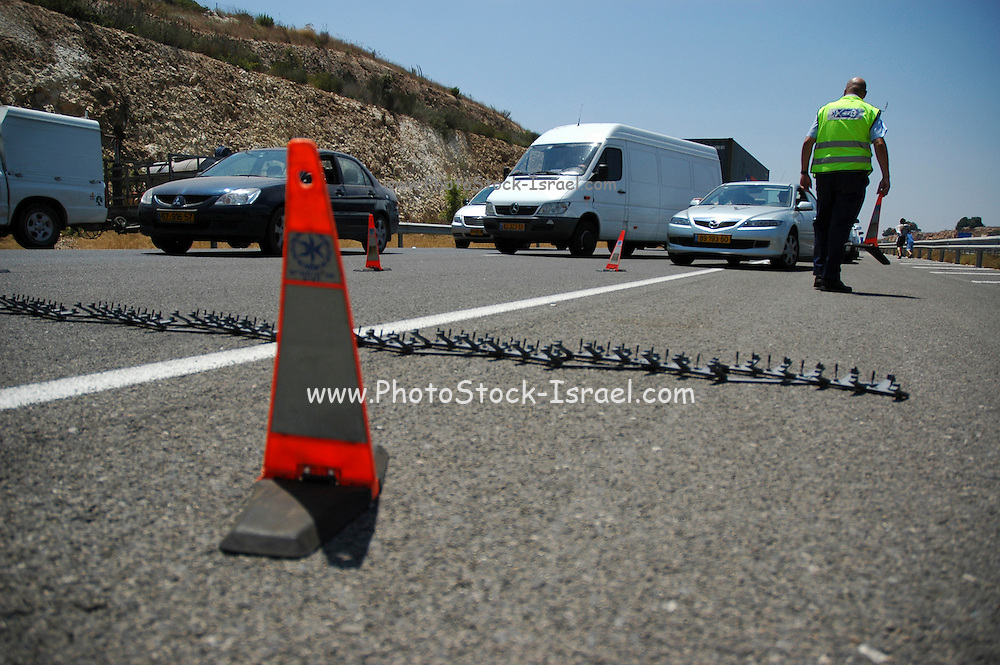 Israel, Judea mountains, police checking the interiors of vehicle at a road block