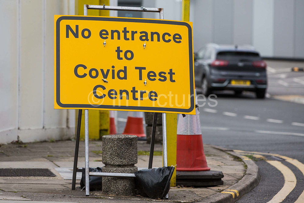 A sign at a site adjacent to a COVID-19 drive-in testing centre provided by the Department of Health and Social Care and facilitated by Slough Borough Council is pictured on 9 September 2020 in Slough, United Kingdom. The UK government is being criticised since a shortage of COVID-19 testing capacity emerged and will shortly implement tighter restrictions on social gatherings amid mounting concern regarding the possibility of a second coronavirus peak following a significant rise in the rolling seven-day national average of the number of cases reported.