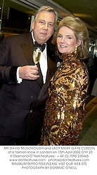 MR DAVID McDONOUGH and LADY MARY-GAYE CURZON  at a fashion show in London on 15th April 2002.OYY 23